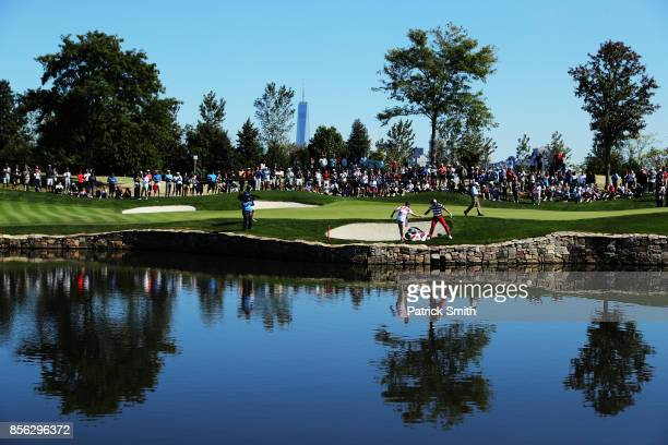 Kevin Chappell of the US Team celebrates after playing from the bunker for eagle on the second hole to go one up over Marc Leishman of Australia and...
