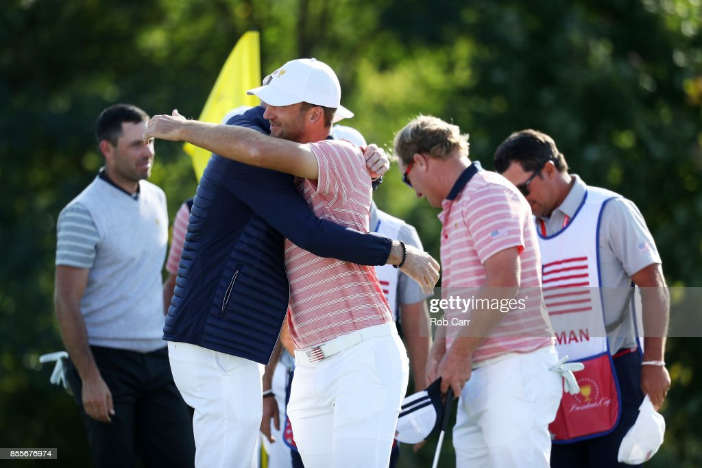 Kevin Chappell of the U.S. Team hugs Captain's assistant Jim Furyk of the U.S. Team on the 13th green during Friday four-ball matches of the Presidents Cup at Liberty National Golf Club on September 29, 2017 in Jersey City, New Jersey.
