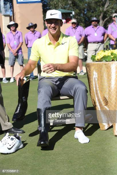 Kevin Chappell puts on the Champion's Boots after winning the Valero Texas Open at the TPC San Antonio Oaks Course in San Antonio TX on April 23 2017