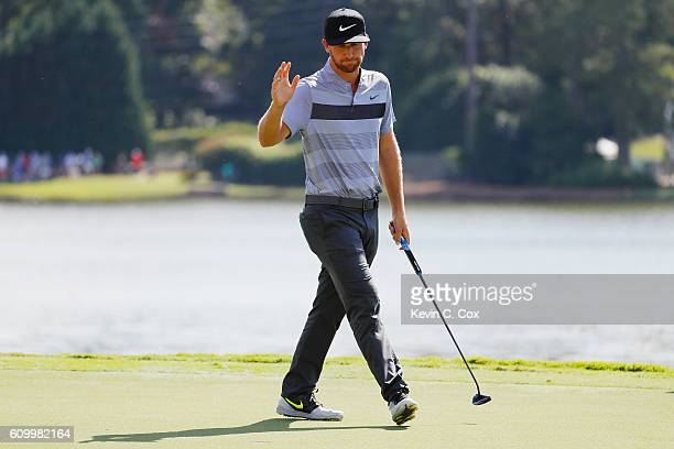 Kevin Chappell waves to the gallery after a birdie on the eighth hole during the second round of the TOUR Championship at East Lake Golf Club on...
