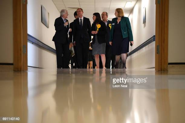 Kevin Cheatle speaks with Liberal Democrats leader Tim Farron and Liberal Democrat MP for Richmond Park Sarah Olney as they visit Kingston Hospital...
