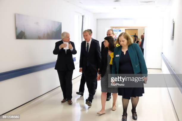 Kevin Cheatle speaks with Nick Clegg MP Liberal Democrats leader Tim Farron during his visit Kingston Hospital on June 1 2017 in Kingston upon Thames...