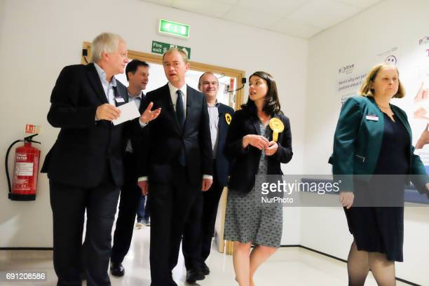 Kevin Cheatle speaks with Nick Clegg MP Liberal Democrats leader Tim Farron and Liberal Democrat MP for Richmond Park Sarah Olney as they visit...