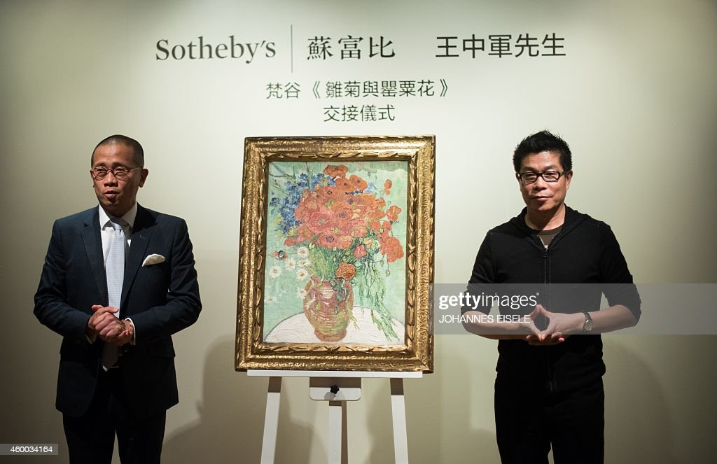 Kevin Ching (L), CEO of Sotheby's Asia and Wang Zhongjun, chairman of the high-powered Huayi Brothers film studio, stand next to the Vincent van Gogh 1890 still life painting 'Nature Morte, Vase Aux Marguerites et Coquelicots' (Still Life, Vase with Daisies and Poppies), at Sotheby's Hong Kong Gallery in Hong Kong on December 6, 2014, after it was handed over to Zhongjun following his purchase of it from Sotheby's in New York on December 5 for 61.8 million USD, according to Shanghai-based news site The Paper. The painting, which was auctioned by Sotheby's in New York, had been valued at 30 to 50 million USD, the report said.