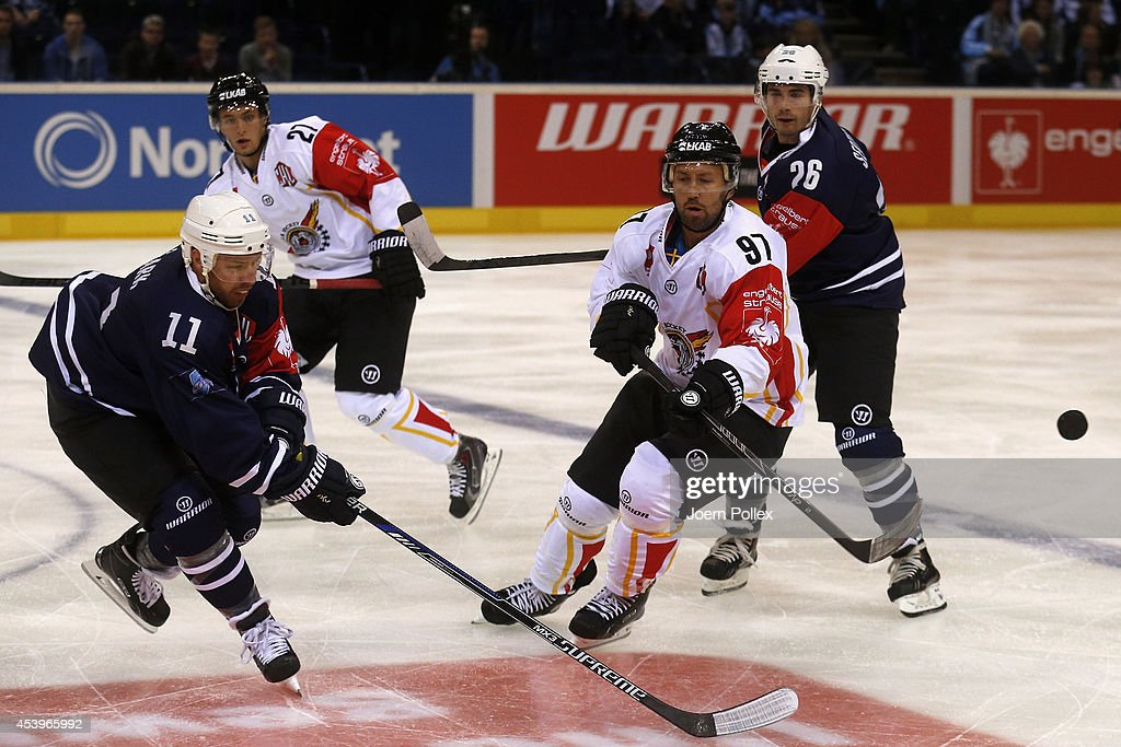 Kevin Clark (L) of Hamburg and Per Ledin of Lulea compete for the puck during the Champions Hockey League group stage game between Hamburg Freezers and Lulea Hockey on August 22, 2014 in Hamburg, Germany.