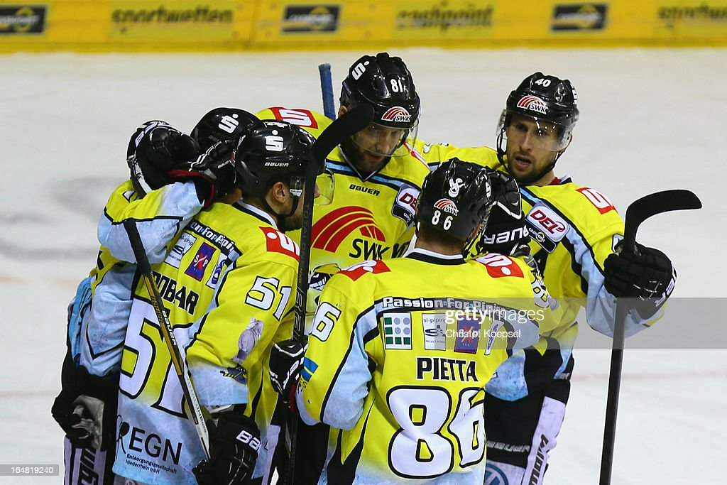 Kevin Clark of Krefeld Pinguine (C) celebrates the first goal with his team mates during the fifth DEL Play-Off-match between Krefeld Pinguine and ERC Ingolstadt at Koenigspalast on March 28, 2013 in Wuppertal, Germany.