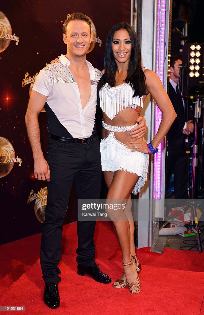 Kevin Clifton and Karen Hauer attend the red carpet launch for Strictly Come Dancing 2014 at Elstree Studios on September 2, 2014 in Borehamwood, England.