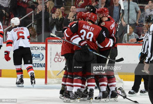 Kevin Connauton Joel Hanley and teammates celebrate a second period goal against the New Jersey Devils at Gila River Arena on December 2 2017 in...