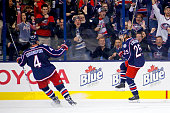 Kevin Connauton of the Columbus Blue Jackets skates over to congratulate William Karlsson of the Columbus Blue Jackets after scoring a goal during...