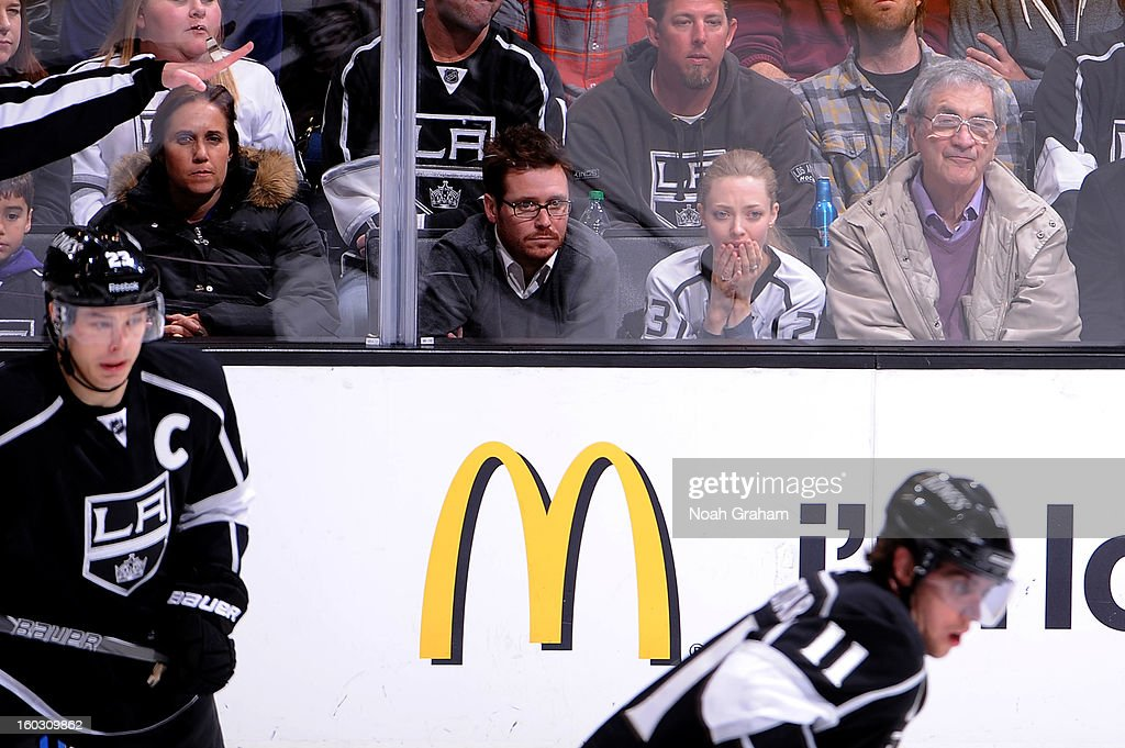 Kevin Connolly and Amanda Seyfried watch the game between the Los Angeles Kings and the Vancouver Canucks at Staples Center on January 28, 2013 in Los Angeles, California.