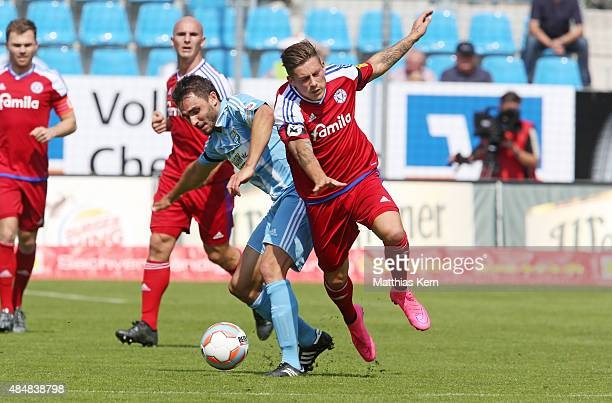 Kevin Conrad of Chemnitz battles for the ball with Steven Lewerenz of Kiel during the third league match between Chemnitzer FC and Holstein Kiel at...