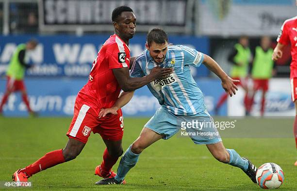 Kevin Conrad of Chemnitz is challenged by Osayamen Osawe of Halle during the Third League match between Chemnitzer FC and Hallescher FC at Stadion an...