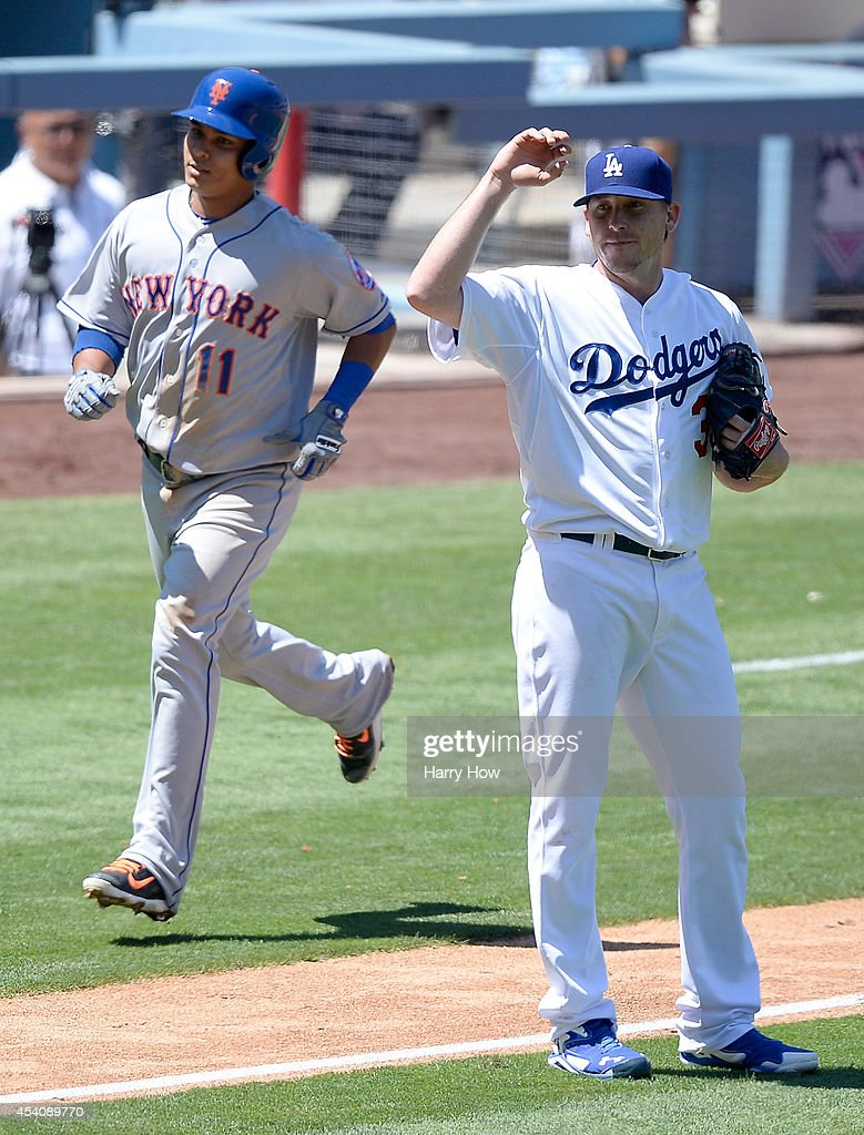 Kevin Correia of the Los Angeles Dodgers reacts after a two run homerun by Ruben Tejada of the New York Mets during the third inning at Dodger...