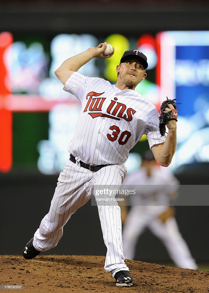 <a gi-track='captionPersonalityLinkClicked' href=/galleries/search?phrase=Kevin+Correia&family=editorial&specificpeople=534607 ng-click='$event.stopPropagation()'>Kevin Correia</a> #30 of the Minnesota Twins delivers a pitch against the Kansas City Royals during the third inning of the game on August 27, 2013 at Target Field in Minneapolis, Minnesota.