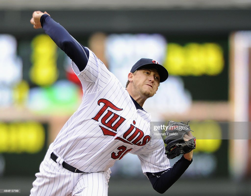 Kevin Correia of the Minnesota Twins delivers a pitch against the Kansas City Royals during the first inning of the game on April 13 2014 at Target...