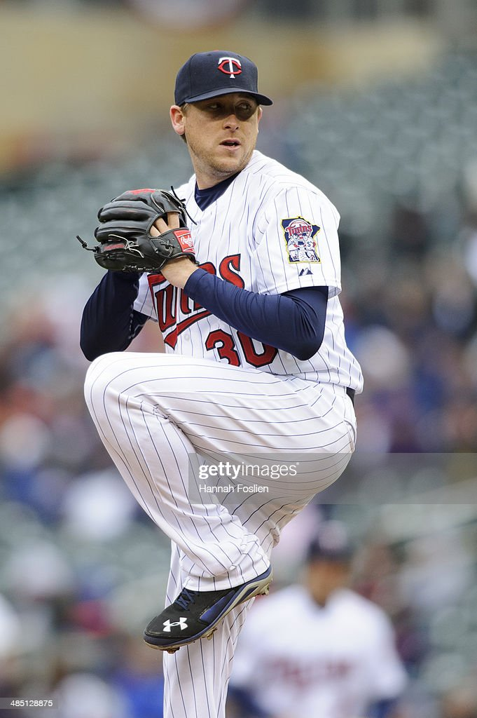 Kevin Correia of the Minnesota Twins delivers a pitch against the Kansas City Royals during the game on April 13 2014 at Target Field in Minneapolis...