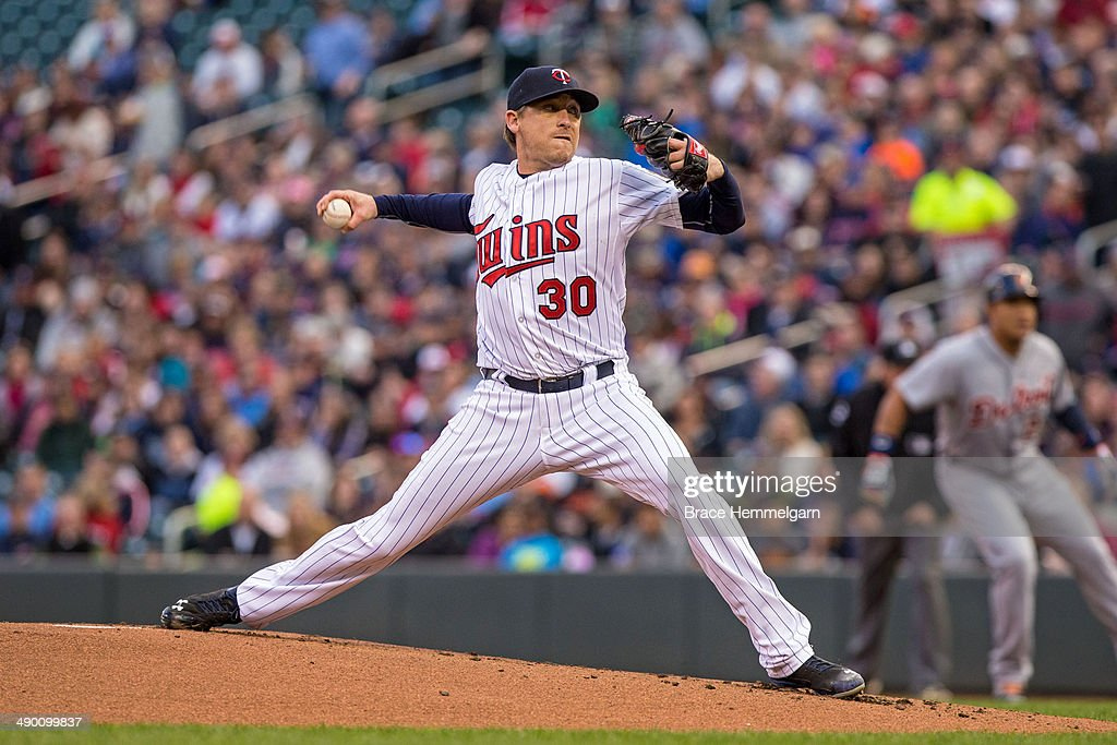 Kevin Correia of the Minnesota Twins pitches against the Detroit Tigers on April 25 2014 at Target Field in Minneapolis Minnesota The Tigers defeated...