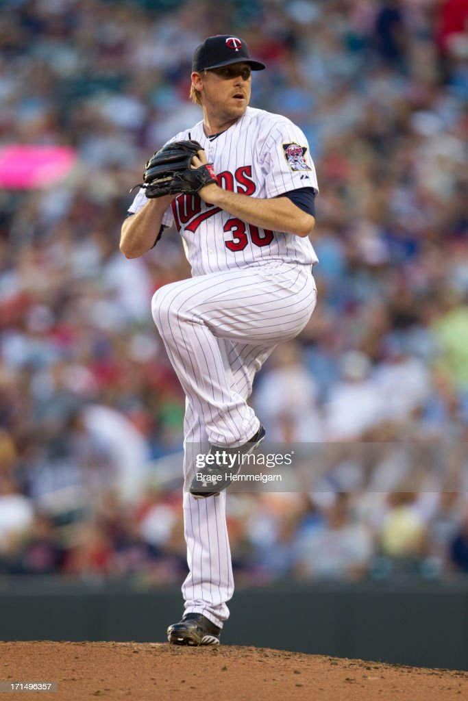 Kevin Correia of the Minnesota Twins pitches against the Philadelphia Phillies on June 13 2013 at Target Field in Minneapolis Minnesota The Phillies...