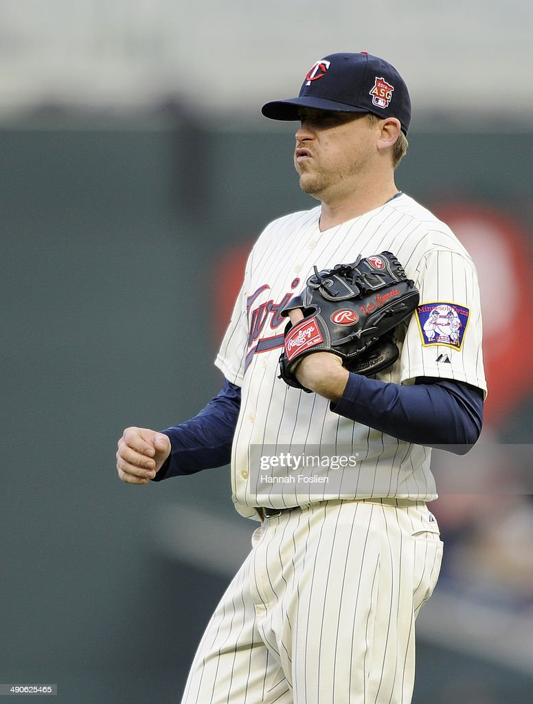 Kevin Correia of the Minnesota Twins reacts during the first inning of the game against the Boston Red Sox on May 14 2014 at Target Field in...