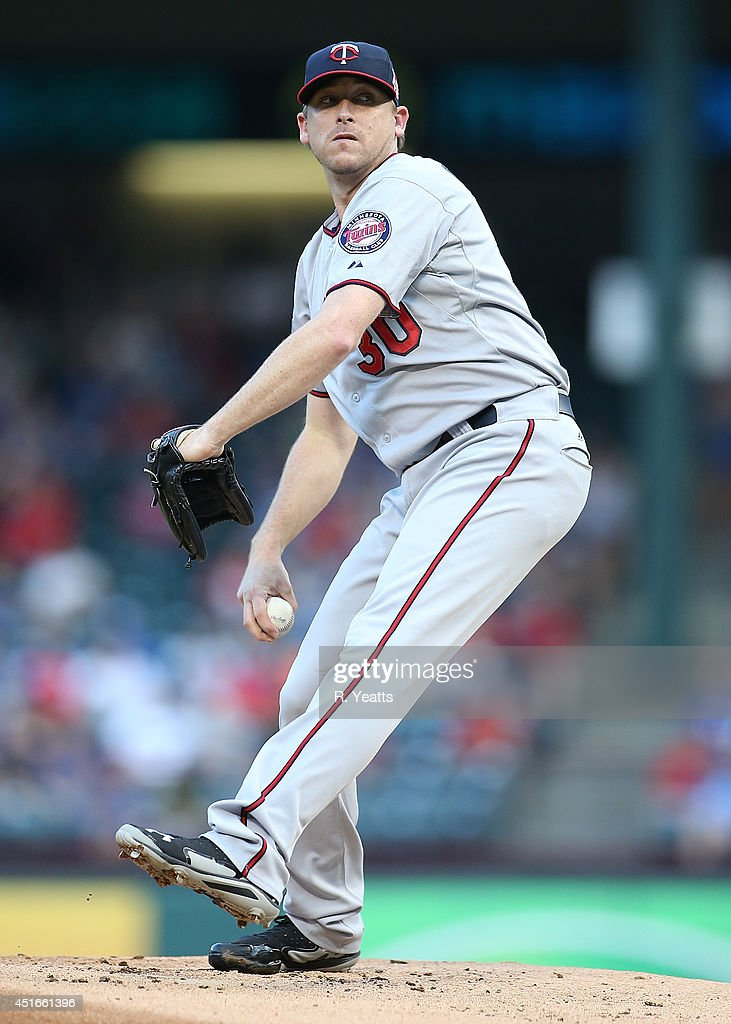 Kevin Correia of the Minnesota Twins throws in the first inning against the Minnesota Twins at Globe Life Park in Arlington on June 27 2014 in...