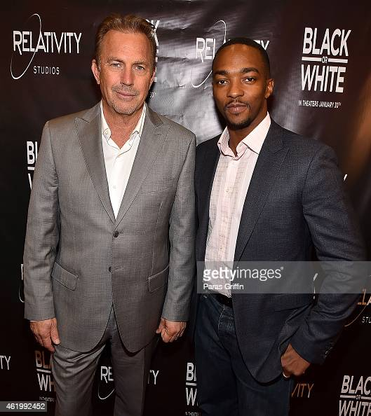 Kevin Costner and Anthony Mackie attend 'Black or White' red carpet screening at Regal Atlantic Station on January 22 2015 in Atlanta Georgia