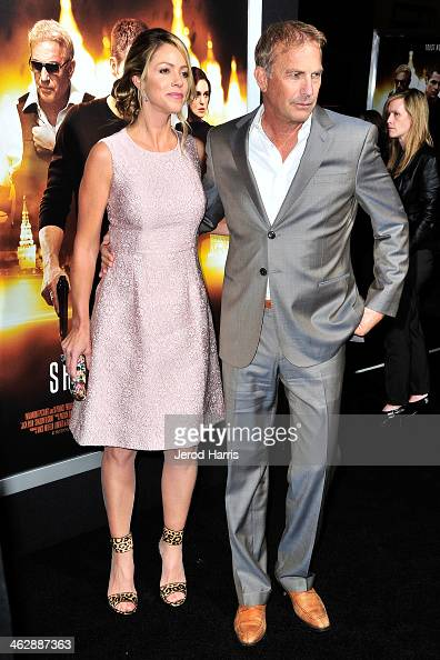 Kevin Costner and Christine Baumgartner arrive at 'Jack Ryan Shadow Recruit' Los Angeles Premiere at TCL Chinese Theatre on January 15 2014 in...