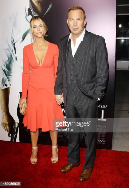 Kevin Costner and Christine Baumgartner arrive at the Los Angeles premiere of '3 Days To Kill' held at ArcLight Cinemas on February 12 2014 in...