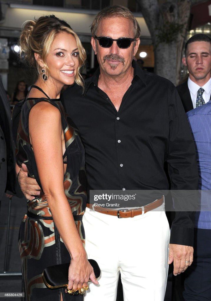 Kevin Costner and Christine Baumgartner arrives at the 'Draft Day' Los Angeles Premiere at Regency Village Theatre on April 7 2014 in Westwood...