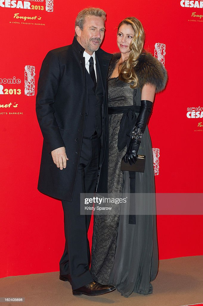 Kevin Costner and Christine Baumgartner attend the Cesar Film Awards 2013 at Le Fouquet's on February 22, 2013 in Paris, France.
