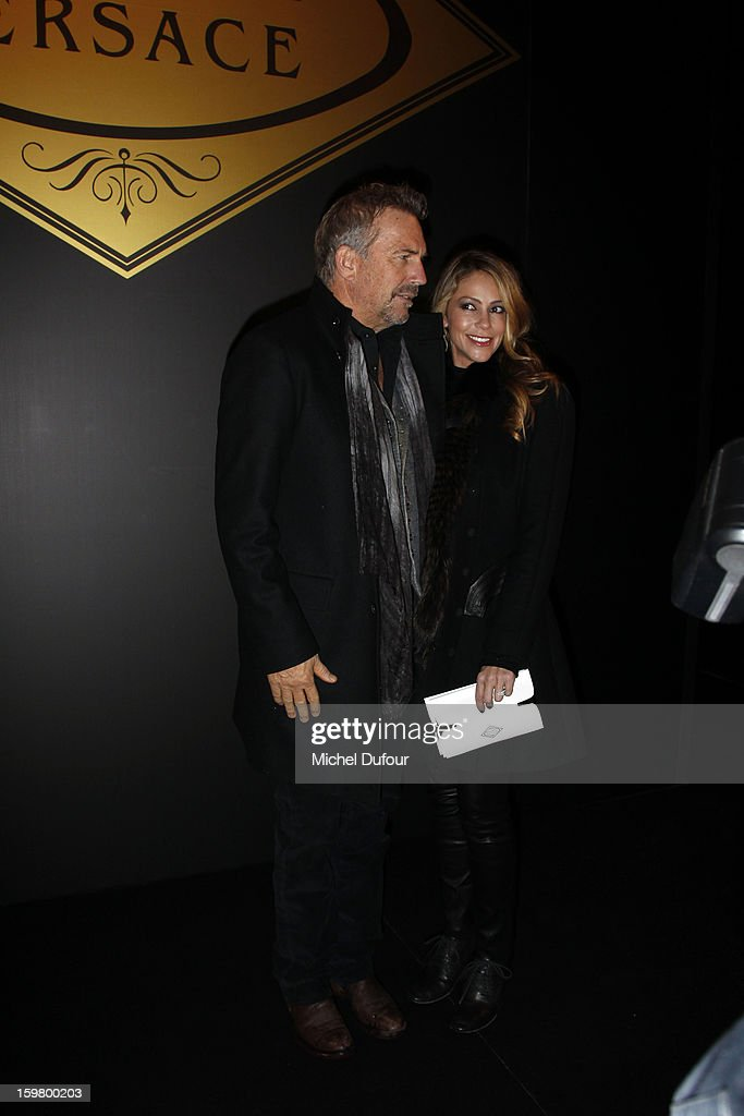Kevin Costner and Christine Baumgartner attend the Versace Spring/Summer 2013 Haute-Couture show as part of Paris Fashion Week at Le Centorial on January 20, 2013 in Paris, France.