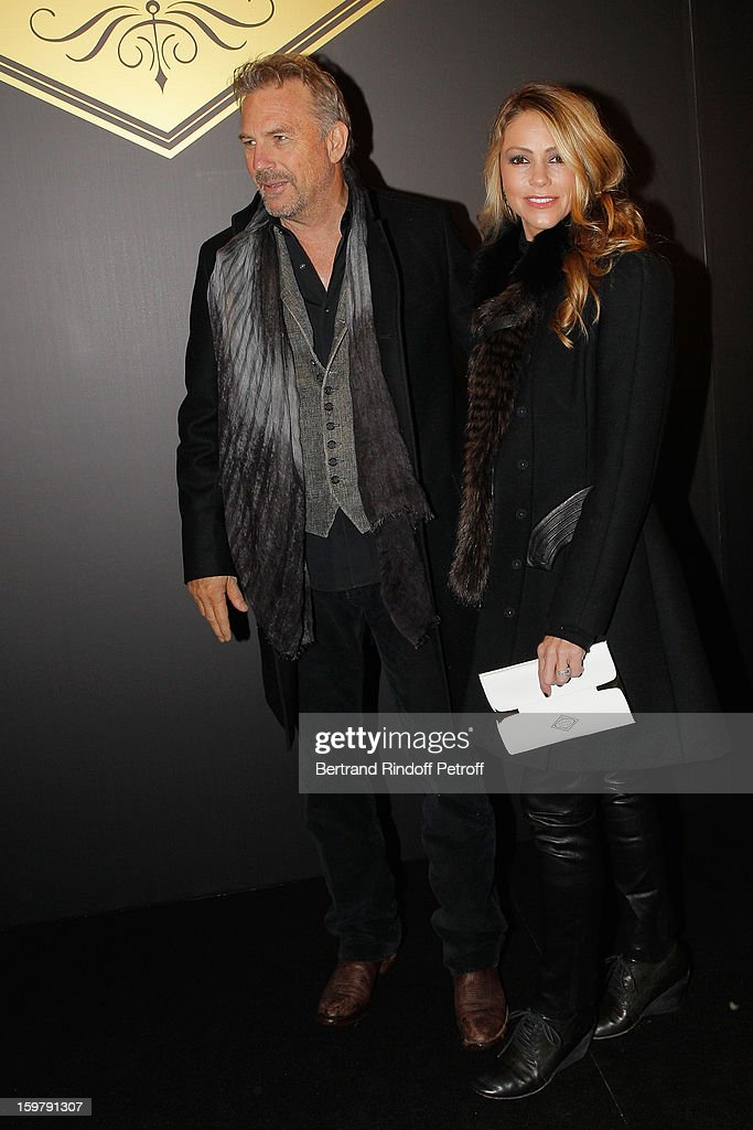 <a gi-track='captionPersonalityLinkClicked' href=/galleries/search?phrase=Kevin+Costner&family=editorial&specificpeople=201719 ng-click='$event.stopPropagation()'>Kevin Costner</a> (L) and his wife Christine attend the Versace Spring/Summer 2013 Haute-Couture show as part of Paris Fashion Week at Le Centorial on January 20, 2013 in Paris, France.