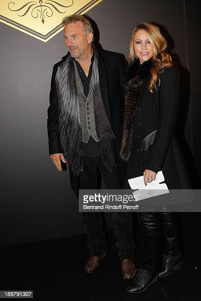 Kevin Costner and his wife Christine attend the Versace Spring/Summer 2013 HauteCouture show as part of Paris Fashion Week at Le Centorial on January...