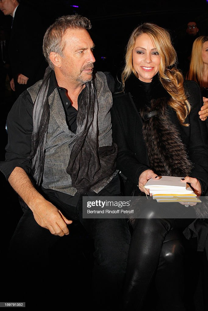 Kevin Costner (L) and his wife Christine attend the Versace Spring/Summer 2013 Haute-Couture show as part of Paris Fashion Week at Le Centorial on January 20, 2013 in Paris, France.