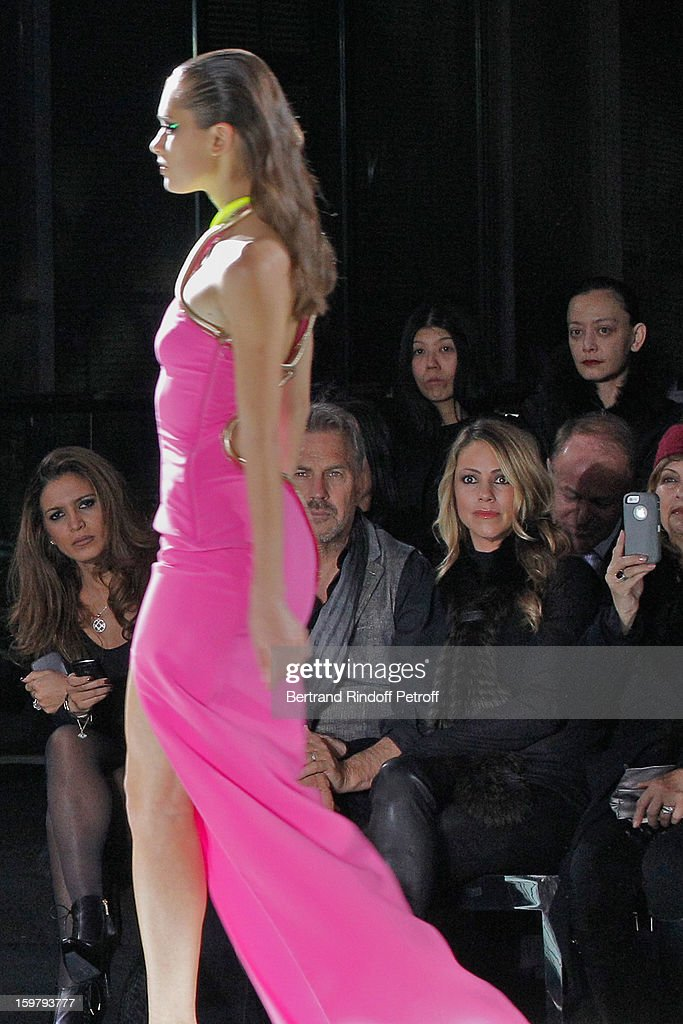 Kevin Costner (2nd R) and his wife Christine (R) attend the Versace Spring/Summer 2013 Haute-Couture show as part of Paris Fashion Week at Le Centorial on January 20, 2013 in Paris, France.