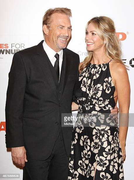 Kevin Costner and his wife Christine Baumgartner arrive at the AARP 14th Annual 'Movies For Grownups' Awards Gala held at the Beverly Wilshire Four...