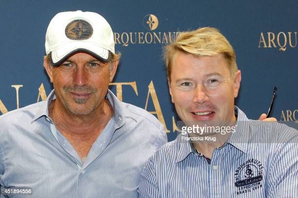 Kevin Costner and Mika Hakkinen attends the Arqueonautas At Panorama on July 09 2014 in Berlin Germany