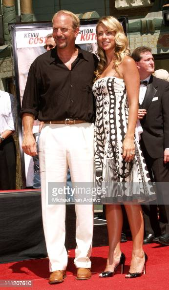 Kevin Costner and wife Christine Baumgartner during Kevin Costner Honored with a Hand and Footprints Ceremony at Grauman's Chinese Theatre at...