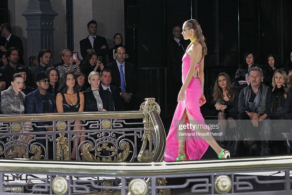 Kevin Costner (2nd R), his wife Christine (R), and (L-R) Melissa George, Ne-Yo, Olivia Munn and Princess Charlene of Monaco attend the Versace Spring/Summer 2013 Haute-Couture show as part of Paris Fashion Week at Le Centorial on January 20, 2013 in Paris, France.