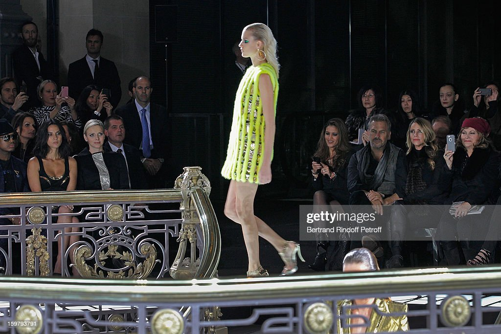 Kevin Costner (3rd R), his wife Christine (2nd R), and (L-R) Ne-Yo, Olivia Munn and Princess Charlene of Monaco attend the Versace Spring/Summer 2013 Haute-Couture show as part of Paris Fashion Week at Le Centorial on January 20, 2013 in Paris, France.