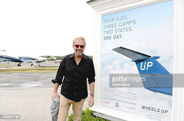 Kevin Costner in Shinola and DuJour Magazine's Jason Binn take a Liberty Helicopter to the East Hampton Airport for a screening of Costner's 'Black...