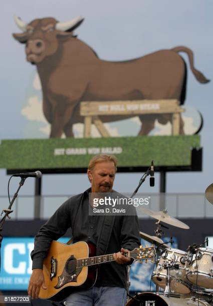 Kevin Costner performs with his band Modern West at the July Fourth celebration at the Durham Bulls Athletic Park July 4 2008 in Durham North...