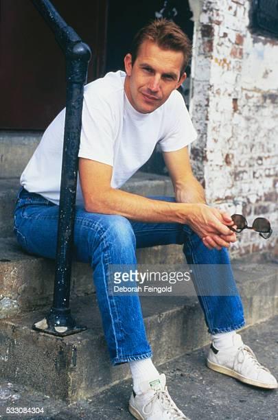 Kevin Costner Seated on Steps