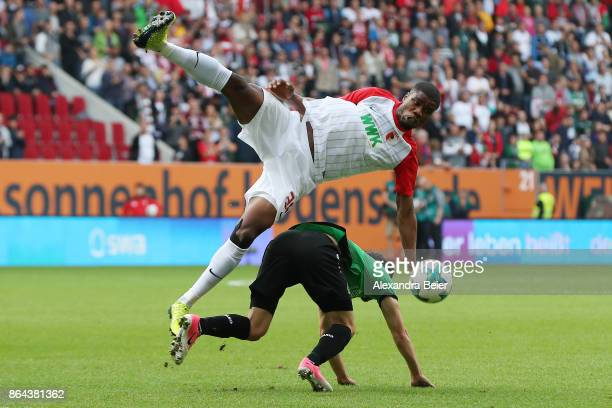 Kevin Danso of Augsburg fights for the ball with Julian Korb of Hannover during the Bundesliga match between FC Augsburg and Hannover 96 at WWKArena...