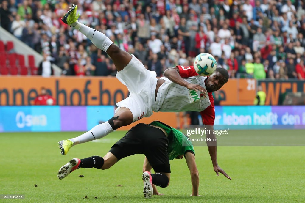 Kevin Danso of Augsburg (top) fights for the ball with Julian Korb of Hannover during the Bundesliga match between FC Augsburg and Hannover 96 at WWK-Arena on October 21, 2017 in Augsburg, Germany.