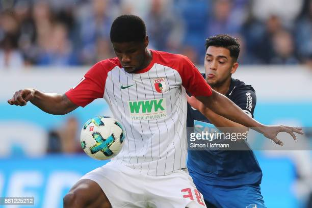 Kevin Danso of Augsburg fights for the ball with Nadiem Amiri of Hoffenheim during the Bundesliga match between TSG 1899 Hoffenheim and FC Augsburg...