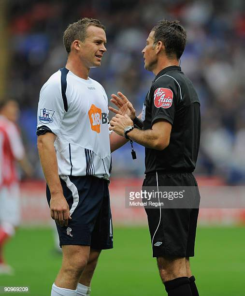 Kevin Davies of Bolton argues with referee Mark Clattenburg during the Barclays Premier League match between Bolton Wanderers and Stoke City at the...