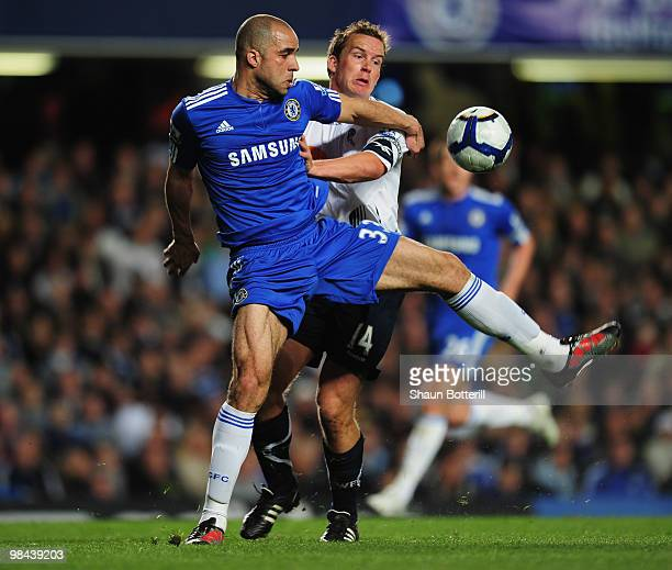 Kevin Davies of Bolton Wanderers battles with Alex of Chelsea during the Barclays Premier League match between Chelsea and Bolton Wanderers at...