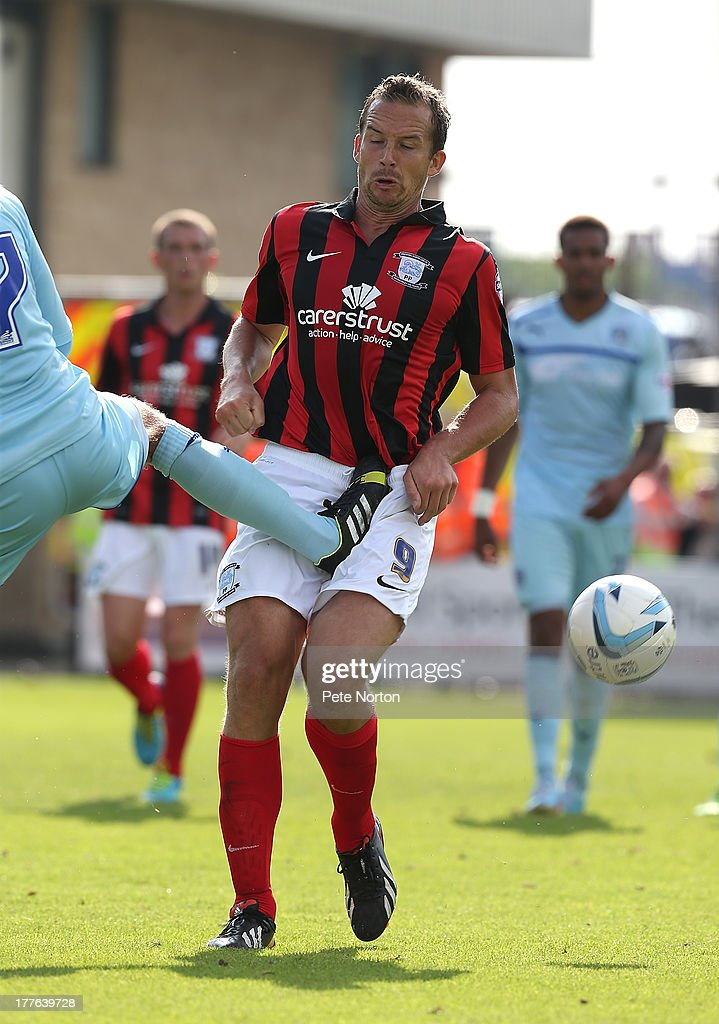 <a gi-track='captionPersonalityLinkClicked' href=/galleries/search?phrase=Kevin+Davies&family=editorial&specificpeople=204360 ng-click='$event.stopPropagation()'>Kevin Davies</a> of Preston North End is fouled by Billy Daniels of Coventry City during the Sky Bet League One match between Coventry City and Preston North End at Sixfields Stadium on August 25, 2013 in Northampton, England.