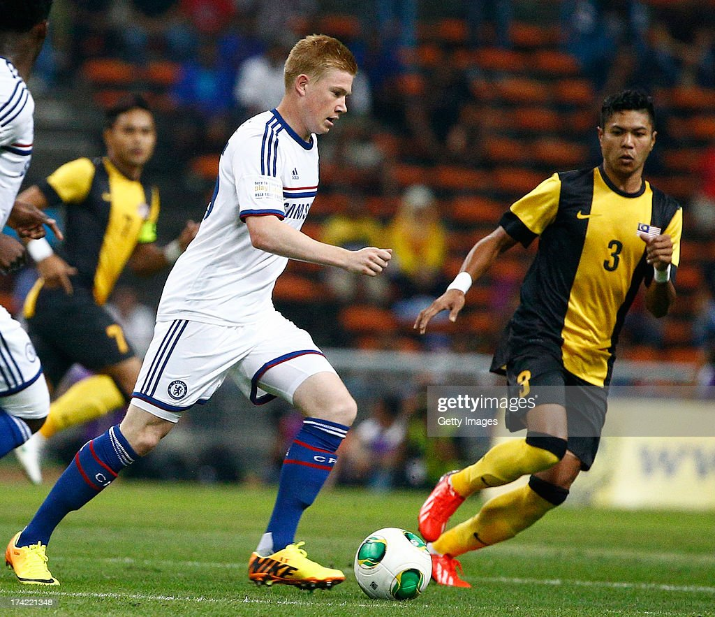 Kevin De Brunye of Chelsea runs with the ball while Azizi Matt Rose of Malaysia looks on durng the match between Chelsea and Malaysia XI on July 21, 2013 at the Shah Alam Stadium, Kuala Lumpur, Malaysia.
