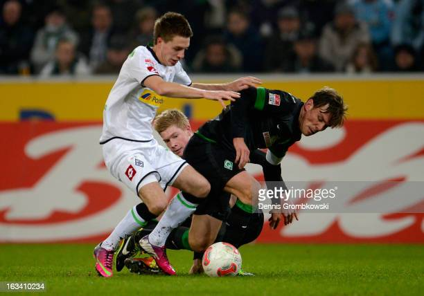 Kevin De Bruyne and Clemens Fritz of Bremen challenge Patrick Herrmann of Moenchengladbach during the Bundesliga match between VfL Borussia...